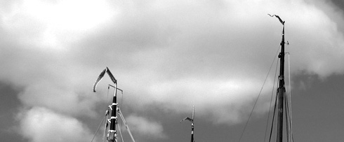 Pennants flying on masts of boats at Governor's Island, Harbor Day