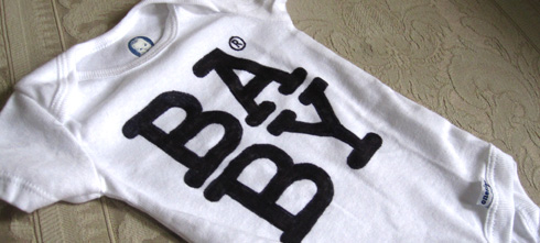 """Onesie for a newborn, designed as """"generic' packaging that says BABY®"""