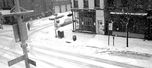 the corner of 5th avenue and prospect place, deserted in snow storm
