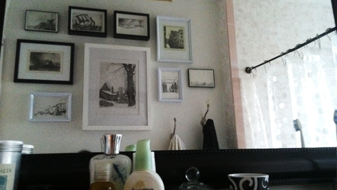 menagerie of pictures on bathroom wall