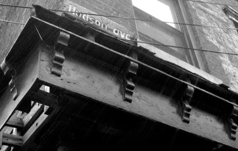 Hudson ave street sign corner buidling