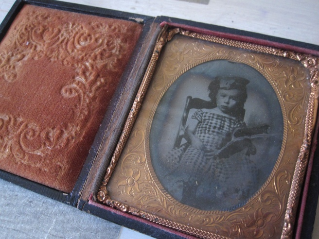 Interior of leather and velvet bound Daguerrotype