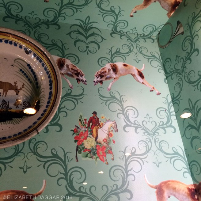 Wallpaper in a case of pottery. The whole museum is underpinned with a kind of tongue-in-cheek attitude.