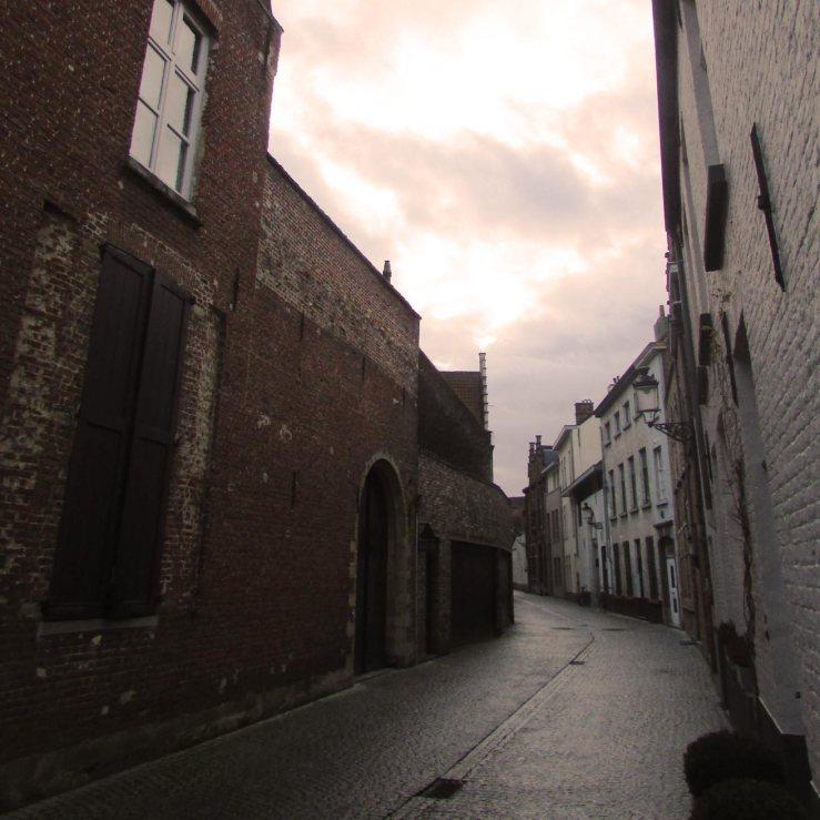 Alluring street in Brugge at dusk