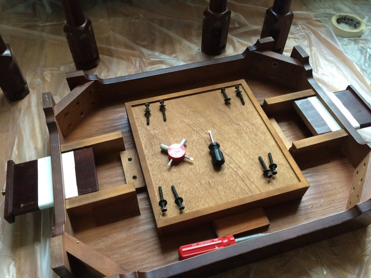 Bottom of the table, showing the beverage rest drawers and the inner section that holds game pieces