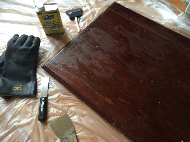 Table top slathered in first coat of streipper
