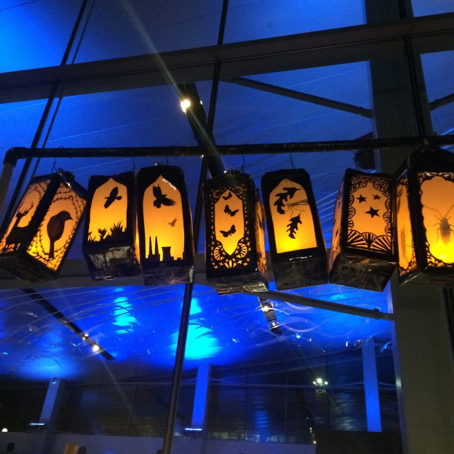 Lanterns above illuminated hand-cranked animation machine by Elizabeth Whitmore Crankie