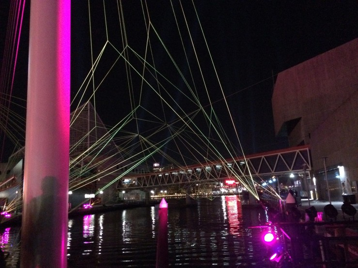 Illuminated lines respond to music as you cross one of the many harbor bridges