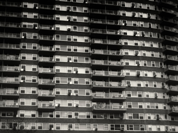 b&w photo of a building facade with many windows