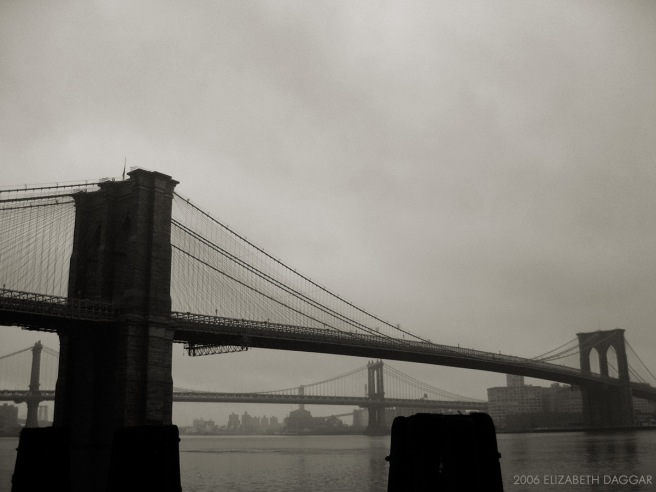 b&w photo pf brookly nbridge, manhattan bridge in distance