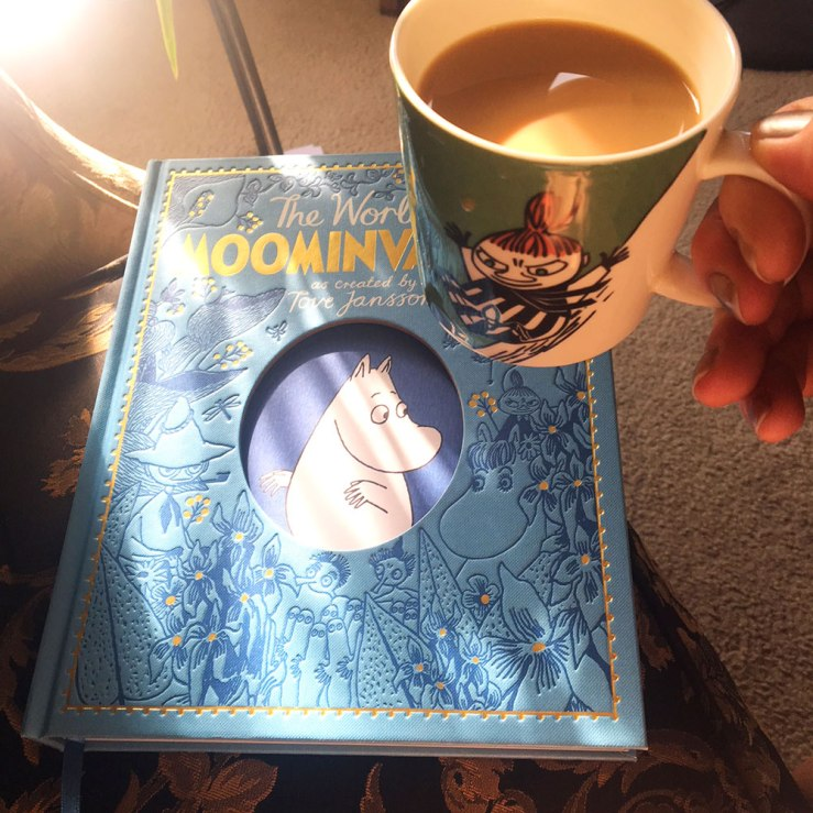 Photo of Moomin book and coffee in a Moomin mug