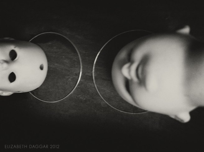 photo of two bisque dolls heads