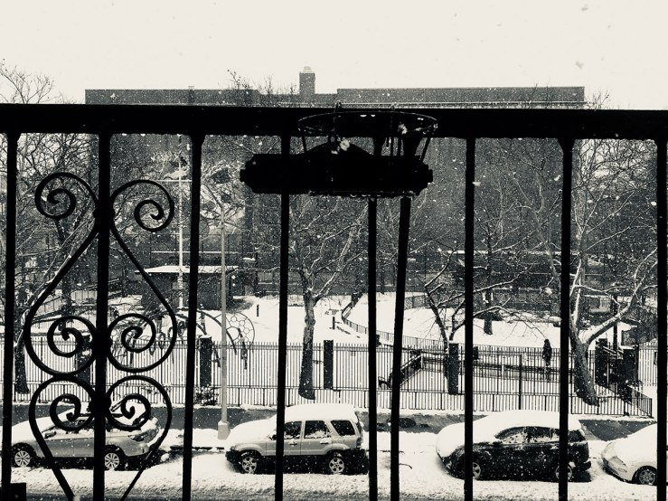 snow falling on the view of the playground (photo)