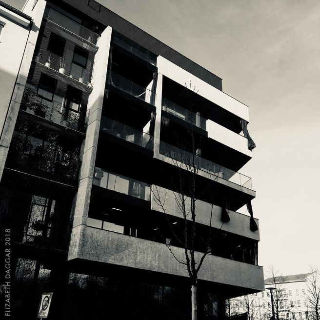 b&w photo of a building displaying brutalist-inspired architecture in Belin