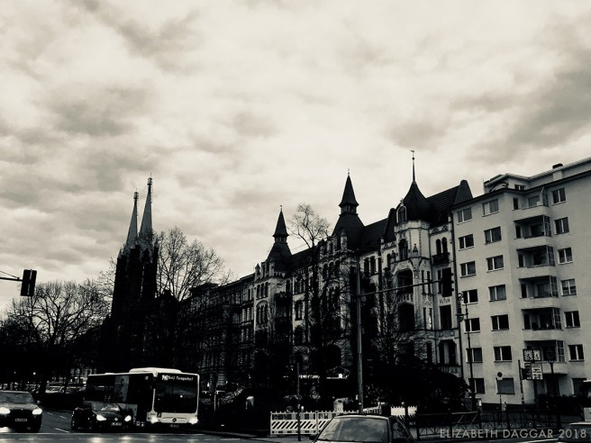 b&w photo on buildings and spires of a cathedral in the distance in Berlin
