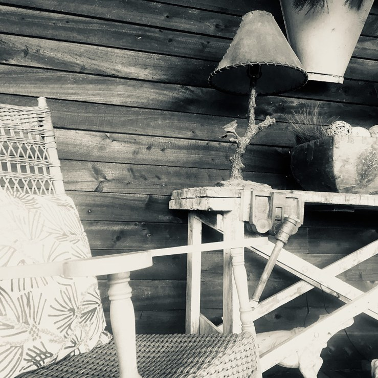 a rocking chair on the vast porch