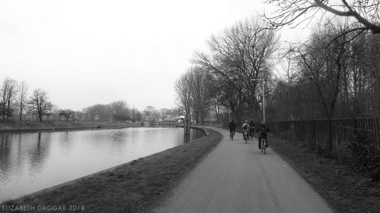 B&W photo of my cycling buddies on a waterside cycle path