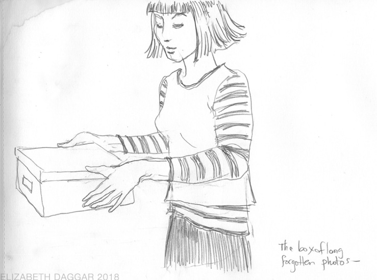 sketch of a woman holding a photo box