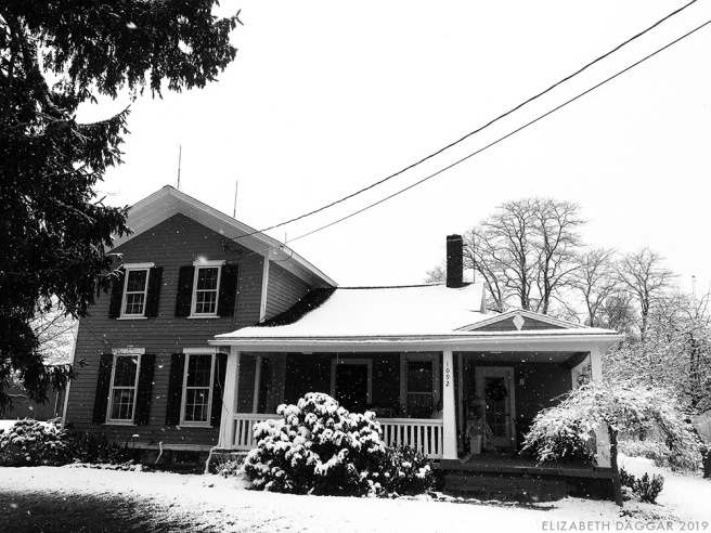the house at the Farm, blanketed in easy snow (b&w photo)