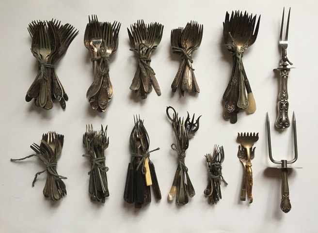 photo of the forks I've decided to keep, bundles for storage. (not including the strawberry forks, which are in a little box, as they are so delicate)
