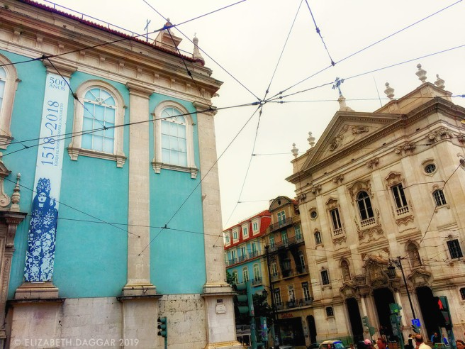 The blue church and trolley wires at the edge of the Baixa neighborhood