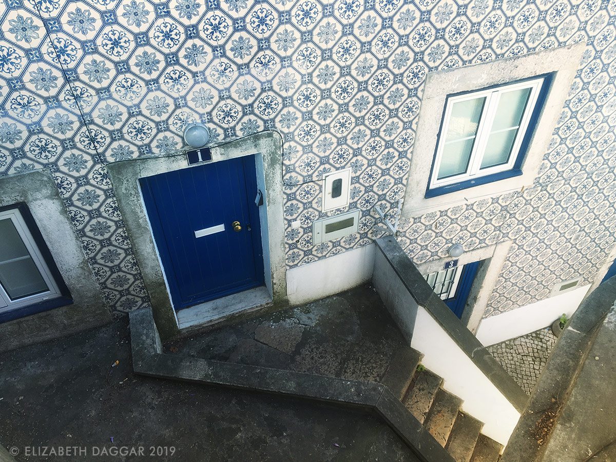 Blue patterned tiles on a house in Alfama, Lisbon