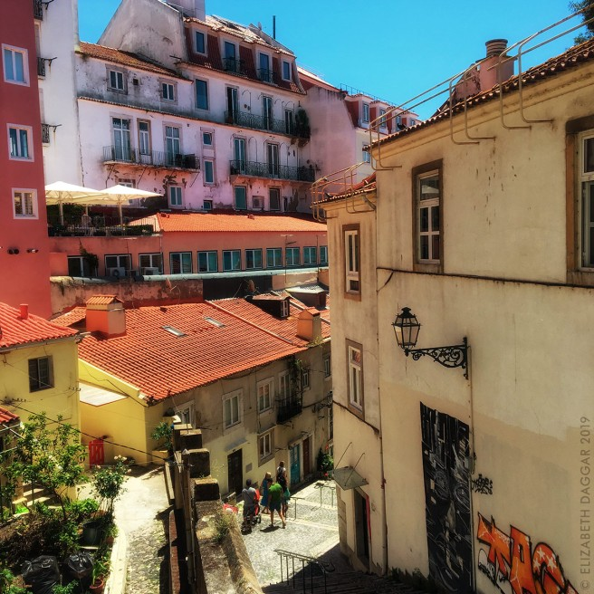Terra cotta tiles cover the rooftops of Lisbon