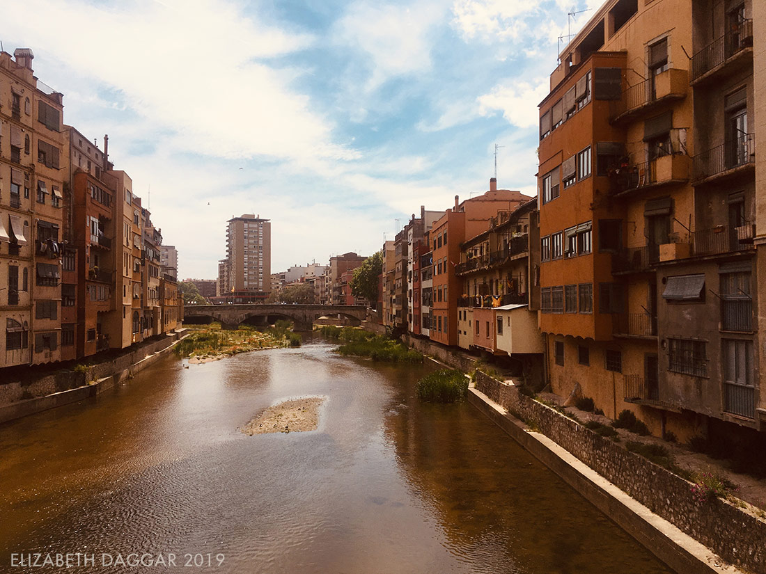 buildings on the banks of the river in Girona, Spain