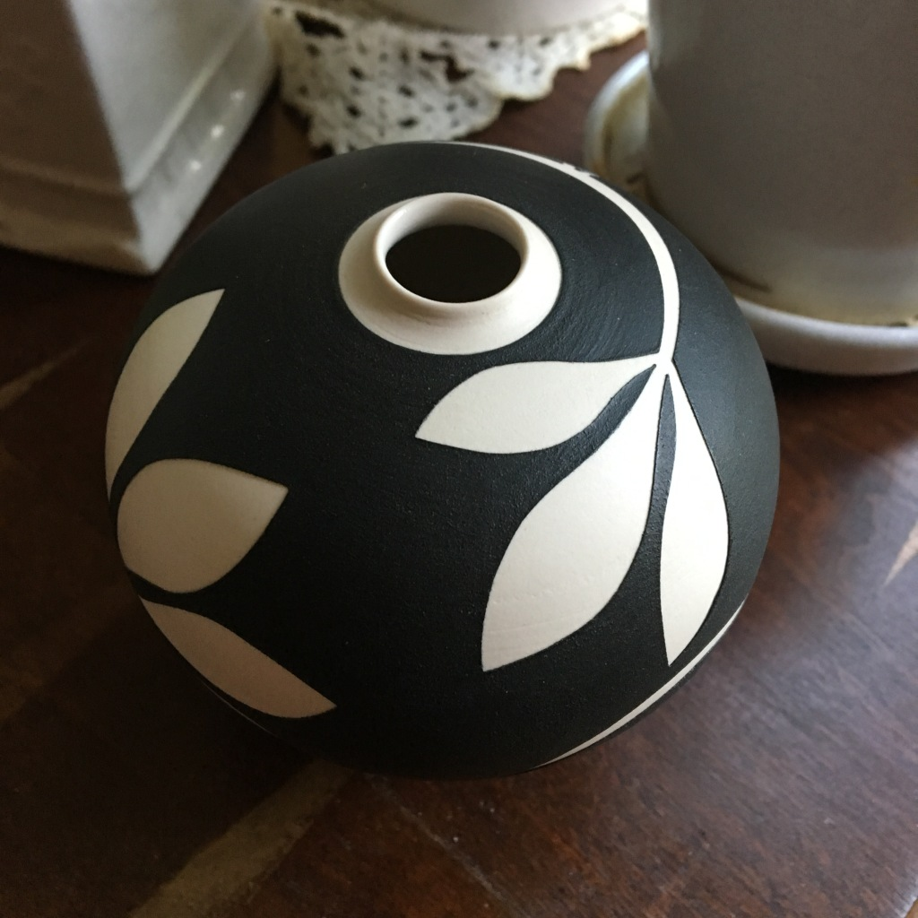 Photo of a small black and white ceramic vase I bought as part of the #ArtistSupportPledge